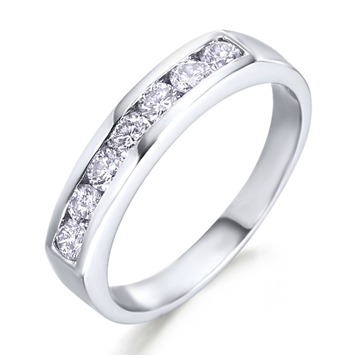 Anillo media carril de oro blanco 18Kt con diamantes
