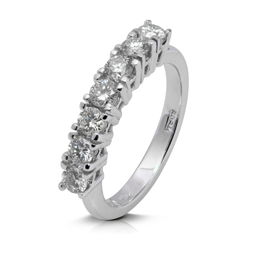 Anillo media alianza grapas de oro blanco 18Kt con diamantes