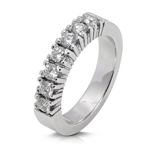 Anillo media alianza grapas de oro blanco 18Kt con diamantes