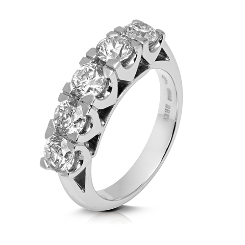 Anillo media alianza grapas de oro blanco 18 Kt con diamantes